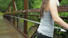 Girl Riding Mountain Bike In The Rain - stock footage