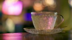 Hot water in glass tea cup Stock Footage