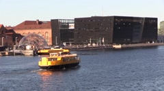 Two yellow harbour buses at the Black Diamond in Copenhagen Stock Footage
