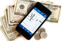 forex trading by mobile phone and money - stock photo
