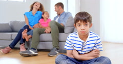 Son apart with family behind Stock Footage