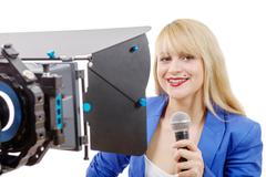 portrait of elegant woman TV reporter , who is smiling - stock photo