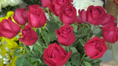 Flower shop, hand of florist arranging red roses Stock Footage
