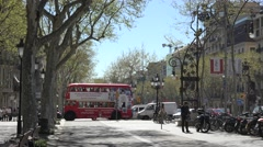4K Congestion traffic street red bus wait stop light Barcelona central city icon Stock Footage