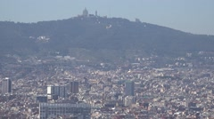 4K Panoramic view Barcelona crowded downtown Tibidabo mountain church hill day   Stock Footage