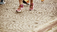 An accelerated footage of the marathoners legs running by the cobbled streets Stock Footage