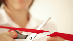 Footage of a woman cutting the red tape celebrating the opening Stock Footage