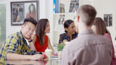 4K Portrait of smiling worker at a fashion magazine in office meeting - stock footage