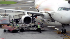 Cargo loading to plane - stock footage