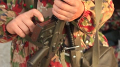 Soldier in Camouflage Uniform with the Machine Gun, Bandolier Stock Footage