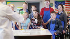 4K Teacher teaching group of students in school science class.  - stock footage