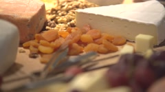Crackers for wine tasting, cheese, nuts, fruits - stock footage
