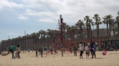 4K Playground sandy beach Barceloneta promenade Barcelona iconic place day icon  Stock Footage
