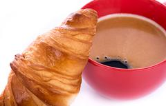 Crispy fresh croissant with coffee - stock photo