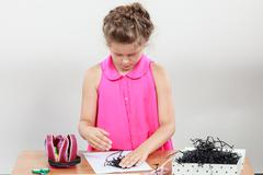 Little girl create composition - stock photo