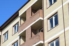 Balconies and windows of a multi-storey new house Stock Photos