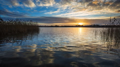 4k timelapse of sun setting over beautiful lake. Tranquil timelapse Stock Footage