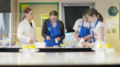 4K Teacher teaching group of students in school science class.  Stock Footage