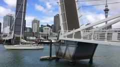 Yacht sail through Wynyard Crossing bridge in Auckland Stock Footage