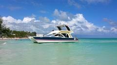 PUNTA CANA, DOMENICAN REPUBLIC JANUARY 29 A yacht boat parked at bavaro beach Stock Footage