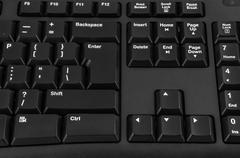 Closeup of black computer keyboard - stock photo