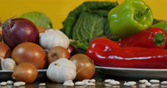 From peppers to black, white and purple onion, close up, dolly shot. - stock footage