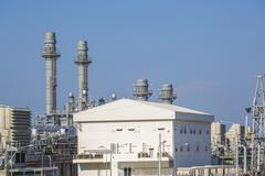 Power plant with blue sky - stock photo