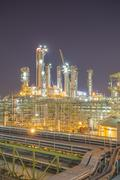 Petroleum and refinery plant on night time - stock photo