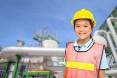 Children with Petroleum plant background Stock Photos