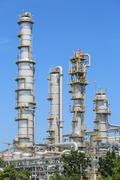 Oil refinery plant on day time - stock photo