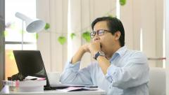 Asian Man Yawning and Sleepy at Work - 4K Resolution Stock Footage