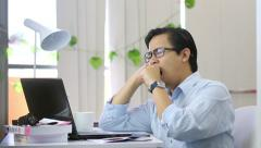 Asian Man Yawning and Sleepy at Work - Slow Motion Stock Footage