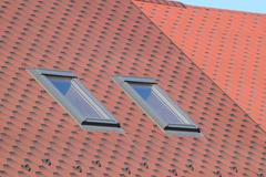 Decorative metal tile on a roof Stock Photos