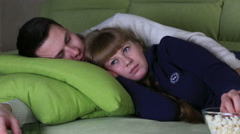 Young couple watching television with popcorn and fall asleep Stock Footage