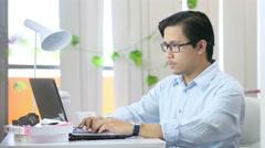Asian Man Typing On Laptop - 4K Resolution Stock Footage