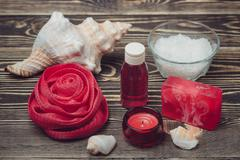 Bath set and essential oil on wooden background - stock photo