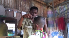 Man getting hair cut with a pair of scissors in barber shop Stock Footage