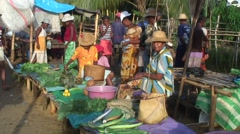 Market in madagascan village selling vegetable in afternoon Stock Footage