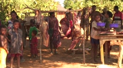 Meat market in small remote village with meat hanging in the heat beside scale Stock Footage