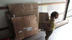 Family Packing Moving Van - stock footage