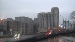 Driving in the city on a rainy afternoon Stock Footage