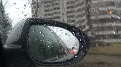 View of side mirror and window, rainy day Stock Footage