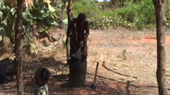 Smith in remote village forming metal tool with hammer Stock Footage