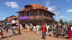 Street life in Madagascar highland city with colonial building Stock Footage