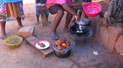 Street life in Madagascar highland city with frying food on street Stock Footage