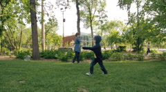 Funny kid run to catch the soap bubbles Stock Footage