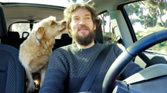 Man in love with his dog traveling in summer in car Stock Footage