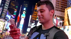 Footage New York City Smiling Young Man Text Messaging Smart Phone Times Square Stock Footage