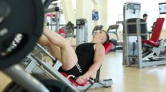 Attractive man doing leg press lying Stock Footage