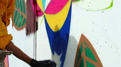 Young guy drawing graffiti on wall - stock footage